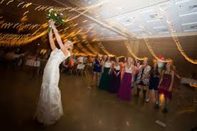 Bride throws bouquet-weddings at PVCC